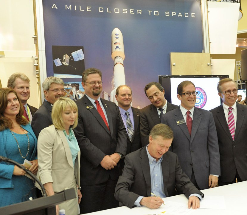 "Governor Hickenlooper signs HB14-1178 ""Sales and Use Tax Exemption for Space Flight Property"". Image Source: 30th Space Symposium"