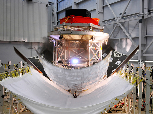 The three panel or fairings encapsulating a stand-in for Orion's service module successfully detach during a test Nov. 6, 2013 at Lockheed Martin's facility in Sunnyvale, Calif. Image Credit: Lockheed Martin