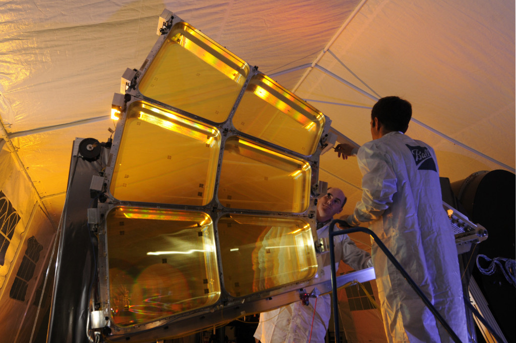 "Instead of using traditional glass mirrors or lenses, MOIRE seeks to diffract light with Fresnel lenses made from a lightweight membrane roughly the thickness of household plastic wrap. MOIRE would house the membranes in thin metal ""petals"" that would launch in a tightly packed configuration. Upon reaching its destination orbit, the satellite would then unfold the petals to create the full-size multi-lens optics. Image Credit: DARPA"