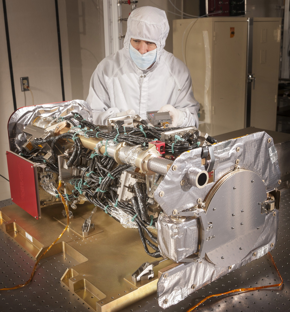 The first NASA Solar Ultraviolet Imager (SUVI) flight unit for the GOES-R series of satellites is being inspected by Lockheed Martin engineer Glenn S. Gradwohl, the SUVI Mechanical Lead, at the Lockheed Martin Advanced Technology Center in Palo Alto, California. Image Credit: Lockheed Martin