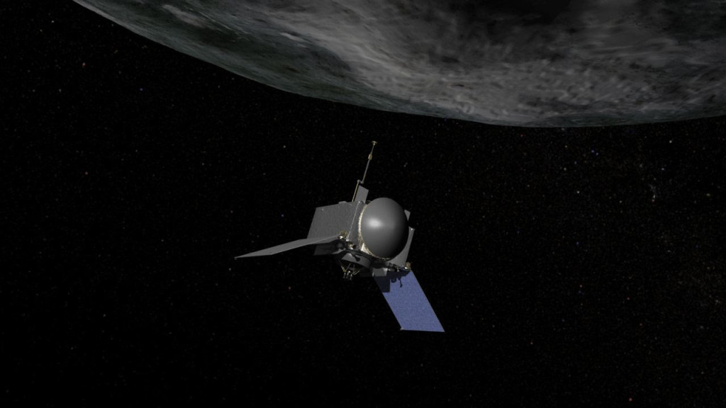 This is an artist's concept of NASA's OSIRIS-REx spacecraft preparing to take a sample from asteroid Bennu. Image Credit: NASA/Goddard/Chris Meaney