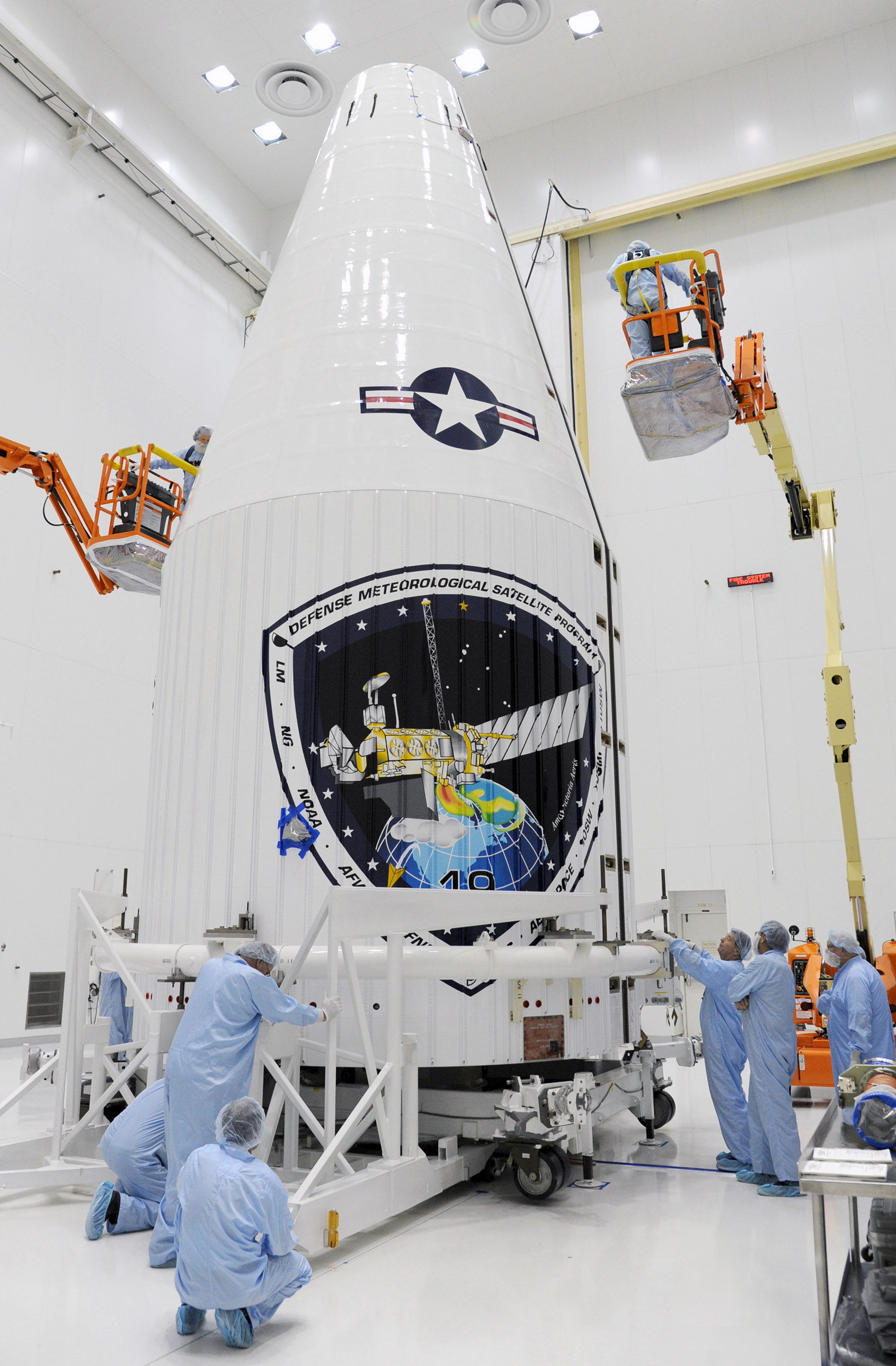 Engineers and technicians at Vandenberg Air Force Base, Calif. encapsulate the 19th Defense Meteorological Satellite Program (DMSP) block 5D weather satellite within its launch fairing on March 14. Launch is scheduled for April 3. Image Source: United Launch Alliance