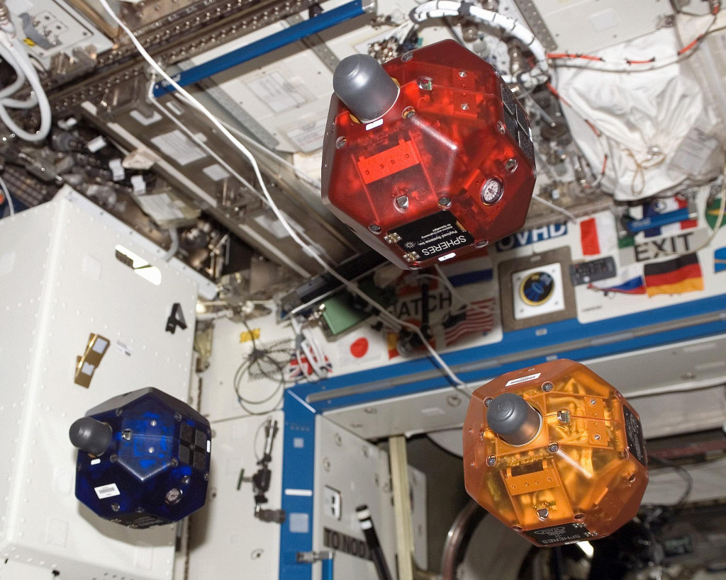 Three satellites fly in formation as part of the Synchronized Position Hold, Engage, Reorient, Experimental Satellites (SPHERES) investigation. This image was taken aboard the International Space Station during Expedition 16 in the U.S. Destiny laboratory module. Image Source: NASA