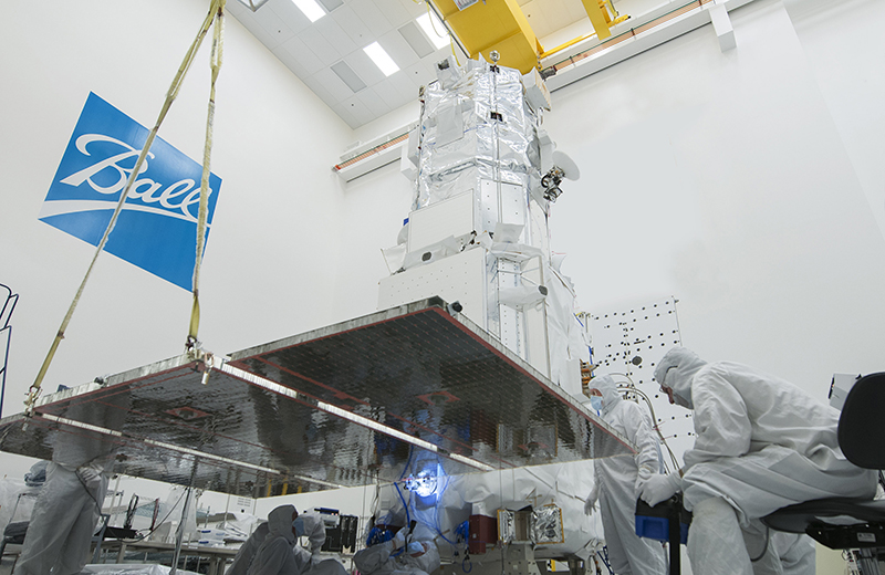 Ball Aerospace technicians inspect a WorldView-3 solar array following completion of environmental tests for the commercial remote-sensing satellite scheduled to launch in August. Image Source: Ball Aerospace