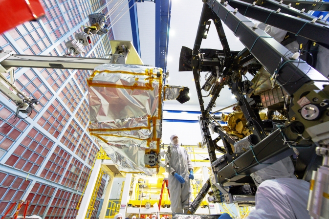 In this photo, engineers install NIRSpec in the heart of Webb. Image Credit: NASA/Chris Gunn