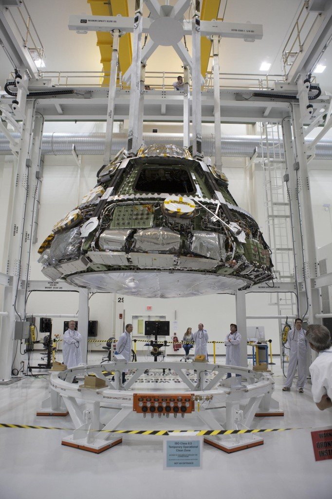 The Orion crew module is placed in a lift fixture to prepare for the heat shield installation. Image Source: Lockheed Martin