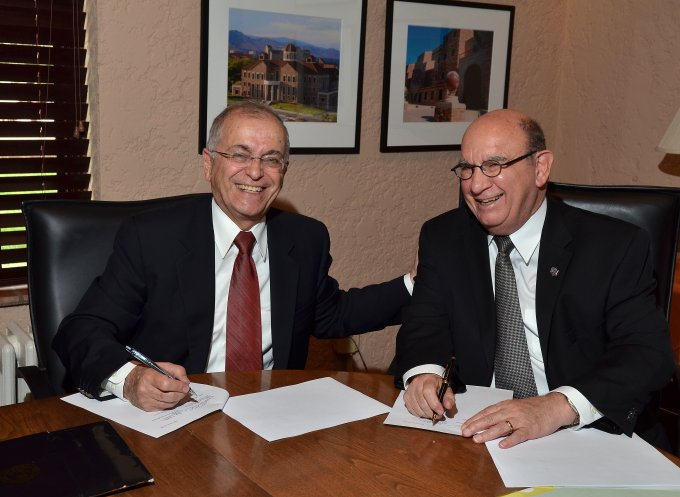 CU-Boulder Chancellor Philip P. DiStefano, right, and Jet Propulsion Lab Director Charles Elachi both sign a memorandum of understanding to continue and broaden a rich tradition of collaboration between JPL and CU-Boulder. Image Source: Casey A. Cass/University of Colorado)