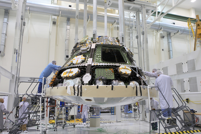 Engineers completed installing the heat shield on NASA's Orion spacecraft ahead of its first trip to space in December. The flight test will send an uncrewed Orion 3,600 miles into space before returning it to Earth for the splashdown in the Pacific Ocean. The heat shield will help protect the Orion crew vehicle from temperatures of about 4,000 degrees Fahrenheit during its reentry into Earth's atmosphere. Image Credit: NASA/Daniel Casper