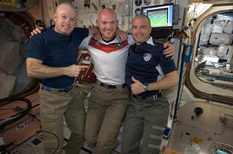 In the spirit of good sportsmanship, U.S. astronauts Reid Wiseman and Steve Swanson had their heads shaved by German crewmate Alexander Gerst. Image Credit: NASA