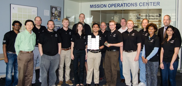 The Miniature X-ray Solar Spectrometer (MinXSS) is a 4-year project to design, build, integrate, test, and operate a 30cm x 10cm x 10cm satellite that will be launched into low-Earth orbit in January 2015 to take observations of the Sun. The team gathered after an end-of-semester review in April 2014. Image Source: LASP