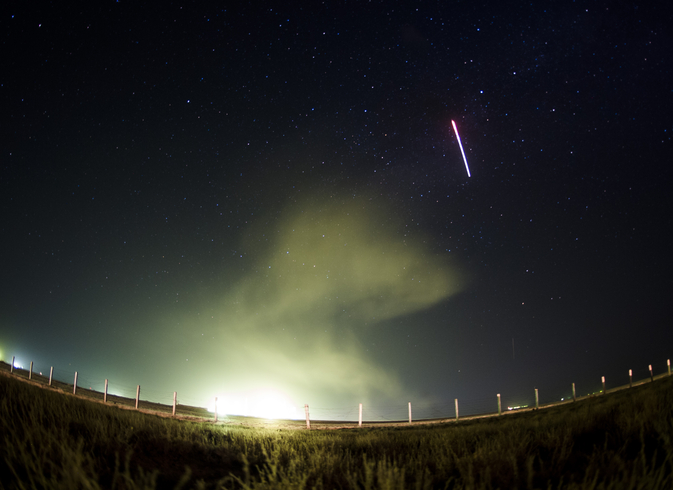 The Soyuz TMA-13M rocket is launched, as seen in this 30-second exposure, with Expedition 40 Soyuz Commander Maxim Suraev, of the Russian Federal Space Agency, Roscosmos, Flight Engineer Alexander Gerst, of the European Space Agency, ESA, and Flight Engineer Reid Wiseman of NASA. Image Source: NASA/Joel Kowsky
