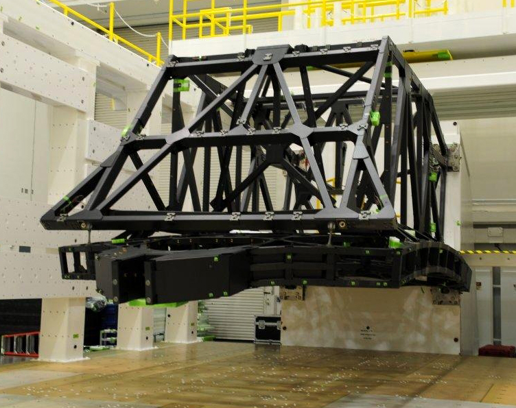 The backplane of NASA's James Webb Space Telescope was mounted to a structure for static load testing to verify it can withstand the rigors of launch and hold the weight needed to support the telescope in space.  Photo Credit: Northrop Grumman