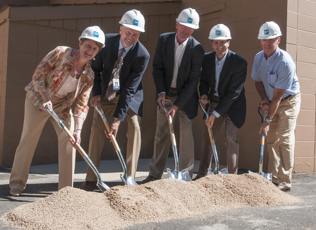Ball officials including Sherri Fike, Cary Ludtke, Tom Deany, Chris Randall and Alex Chernushin toss a shovel of construction sand at the groundbreaking for Ball's new GEMS clean room. Image Source: Ball Aerospace & Technologies Corp.