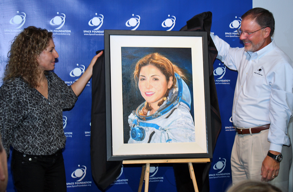 Anousheh Ansari's official portrait was unveiled at the Space Foundation Discovery Center. It will remain on display at the Center. Image Credit: Colorado Space News