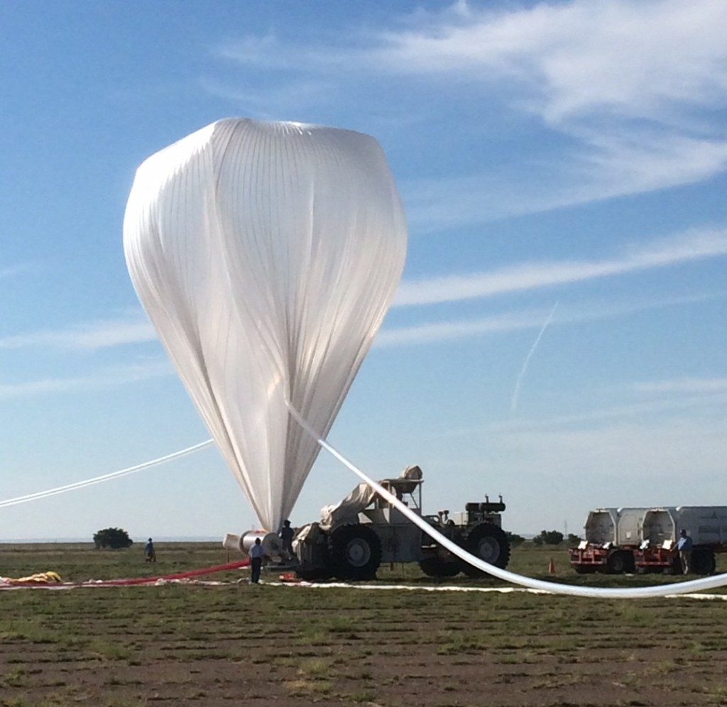 A NASA high-altitude balloon is inflated with helium in preparation for the HySICS science demonstration flight. Image Credit: NASA Balloon Program Office