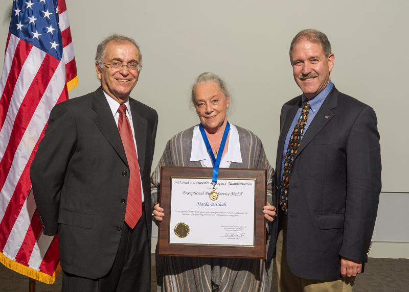 NASA's Charles Elachi, Director, Jet Propulsion Laboratory and John Grunsfeld, NASA's Associate Administrator for Science Mission Directorate congratulate Ball Aerospace's Marda Barthuli on her NASA Exceptional Public Service Medal for work on the CloudSat mission. Image Source:  PRNewsFoto/Ball Aerospace