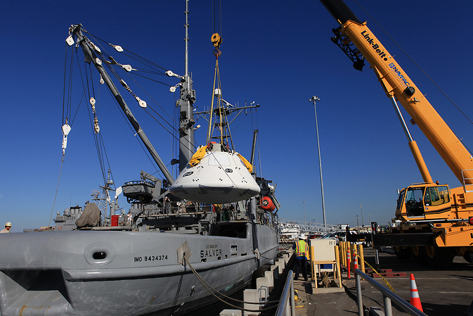 At Naval Base San Diego in California, a crane is used Sept. 11 to transfer the Orion boilerplate test vehicle into the USS Salvor, a safeguard-class rescue and salvage ship that will be used for Underway Recovery Test 4A. Image Credit: NASA/Kim Shiflett