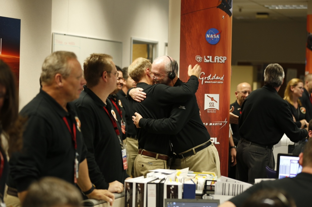 Members of the mission team at the Lockheed Martin Mission Support Area in Littleton, Colorado, celebrate after successfully inserting NASA's Mars Atmosphere and Volatile Evolution (MAVEN) spacecraft into orbit around Mars. Image Credit: Lockheed Martin