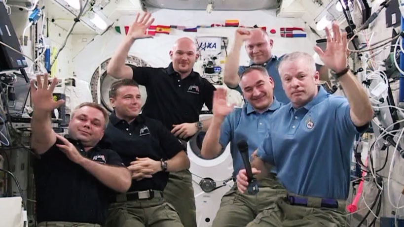 NASA astronaut Steve Swanson (right foreground) handed over command of the International Space Station to Roscosmos cosmonaut Max Suraev (left foreground) Tuesday afternoon. Image Credit: NASA TV