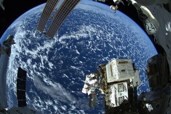 Alexander Gerst shared this spectacular view of Reid Wiseman above the Earth as they conducted a spacewalk to replaced a failed fuel pump. Image Credit: ESA/NASA