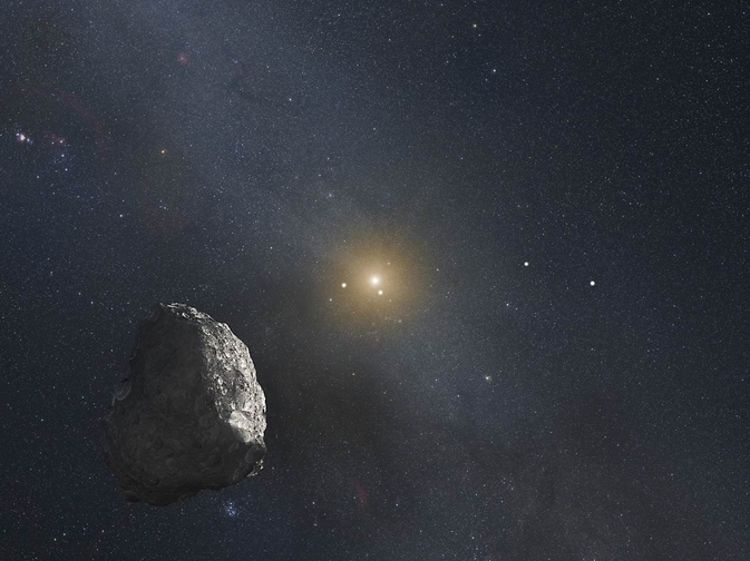 This is an artist's impression of a Kuiper Belt object (KBO), located on the outer rim of our solar system at a staggering distance of 4 billion miles from the Sun. Image Credit: NASA, ESA, and G. Bacon (STScI)