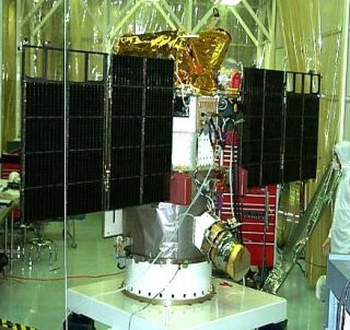 The DSCOVR spacecraft with its solar arrays extended in a Goddard Space Flight Center clean room. Image Credit: NASA