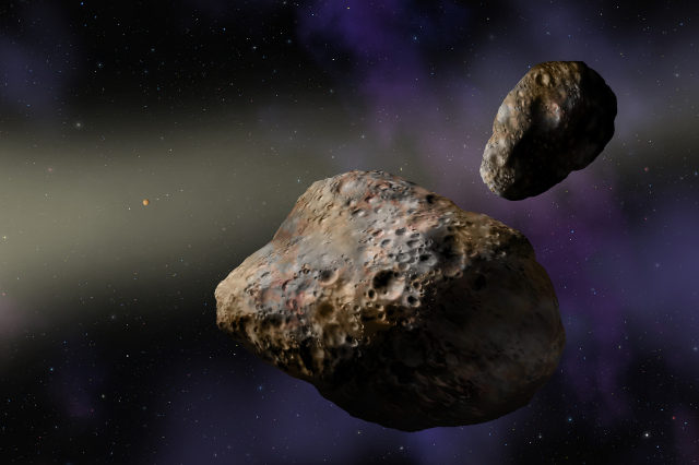 Artist's rendering of the binary asteroids Patroclus (center) and Menoetius. Image Credit: W. M. Keck Observatory/Lynette Cook