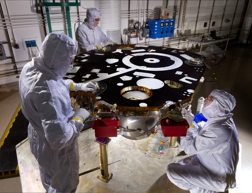 Technicians in a Lockheed Martin clean room near Denver prepare NASA's InSight Mars lander for propulsion proof and leak testing on Oct. 31, 2014. Following the test, the lander was moved to another clean room for start of the mission's assembly, test and launch operations (ATLO) phase. Image Credit: NASA/JPL-Caltech/Lockheed Martin