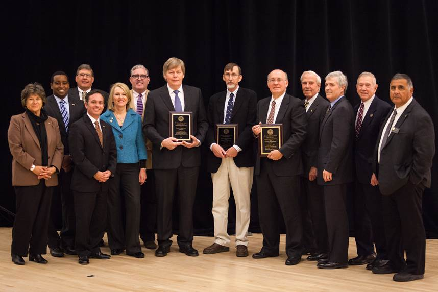 The CU Board of Regents poses with three distinguished professor recipients. Image Credit: Jeff Foster/University of Colorado Colorado Springs