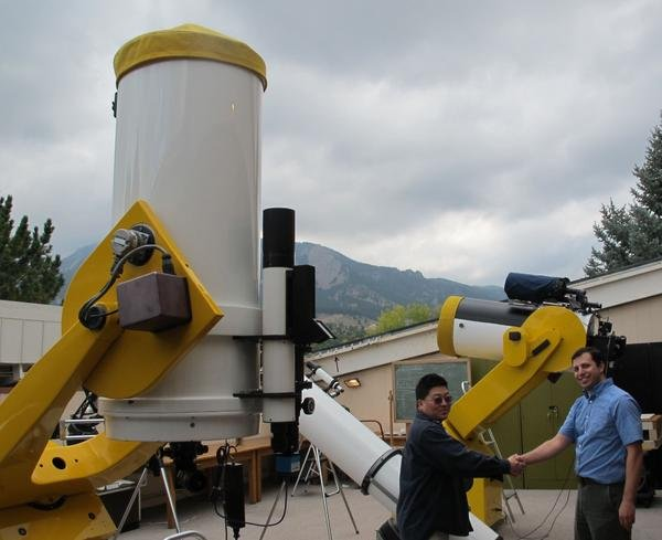 Longtime Summer Science Program Academic Director Tracy Furutani, left, shown here at CU-Boulder¹s Sommers-Bausch Observatory with observatory Director Seth Hornstein. Image Credit: Sommers-Bausch Observatory, CU-Boulder
