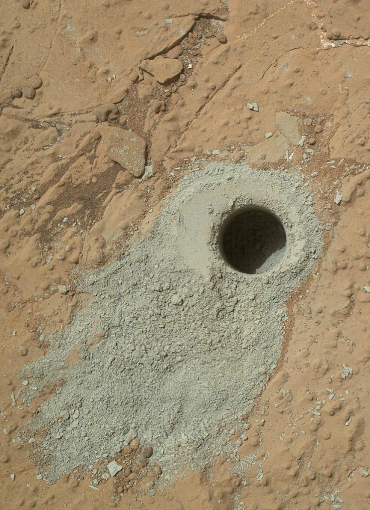 "NASA's Mars rover Curiosity drilled into this rock target, ""Cumberland,"" during the 279th Martian day, or sol, of the rover's work on Mars (May 19, 2013) and collected a powdered sample of material from the rock's interior. Image Credit: NASA/JPL-Caltech/MSSS"