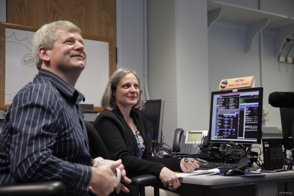 New Horizons Mission Operations Manager Alice Bowman and operations team member Karl Whittenburg watch the screens for data confirming that the New Horizons spacecraft had transitioned from hibernation to active mode on Dec. 6. Image Credit: NASA