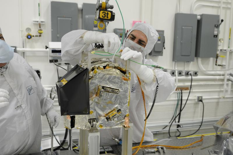 A Ball Aerospace technician prepares to integrate the Ozone Mapping Profiler Suite (OMPS) to the Joint Polar Satellite System spacecraft. OMPS and the Clouds and Earth's Radiant Energy System are the first two of five instruments to be integrated to JPSS-1, the nation's next polar-orbiting weather satellite for NOAA and NASA, scheduled to launch in 2017.  Image Credit: Ball Aerospace & Technologies Co)