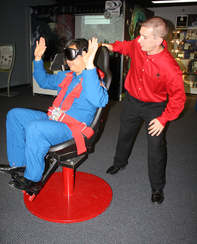 Former NASA astronaut Dr. Leroy Chiao, the Space Foundation's special advisor - human spaceflight, takes a spin in the Barany Chair. Image Credit: Space Foundation Discovery Center
