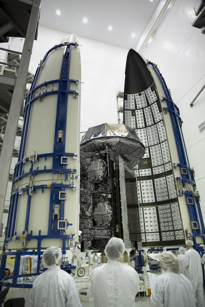The U.S. Navy's Mobile User Objective System (MUOS)-3 satellite is encapsulated in its payload fairings for a scheduled Jan. 20, 2015 launch aboard a United Launch Alliance Atlas V rocket. Image Credit: Lockheed Martin