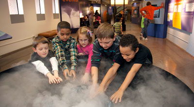 Hands-on exhibits such as this one simulating clouds are a destination for thousands of tourists and school children who visit NCAR's Mesa Lab each year. UCAR, which curates the NCAR exhibits, has been accepted to join a leading group of national museum and cultural organizations as an Affiliate of the Smithsonian Institution. Image Credit: UCAR
