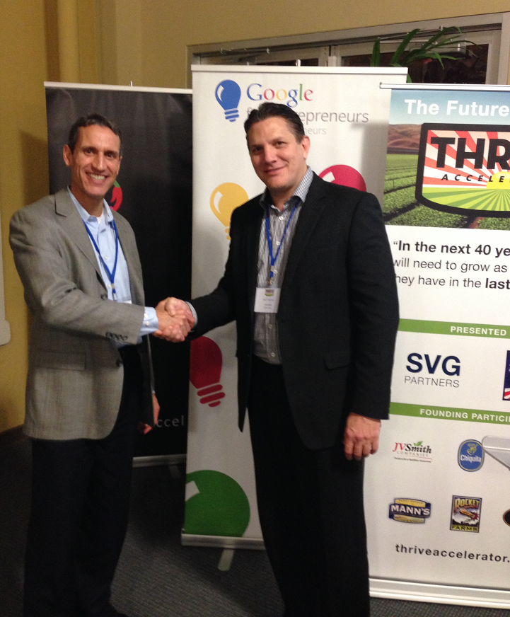 GeoVisual CEO Jeff Orrey (left), is congratulated by John Stanton, Founding Partner of SVG Partners, for winning the 2015 THRIVE Accelerator competition in San Jose, CA. Image Credit: GeoVisual Analytics