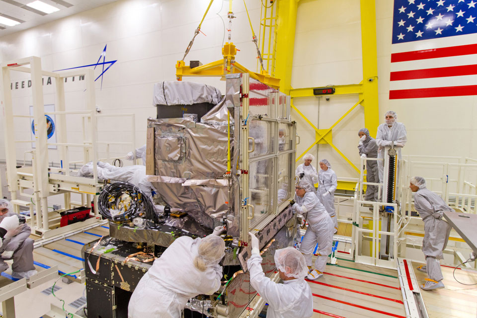 The GOES-R Advanced Baseline Imager (ABI) is installed onto the GOES-R spacecraft at Lockheed Martin in Littleton, Colorado, on October 13, 2014. The ABI resides on the Earth-Pointing Platform of the spacecraft, along with the Geostationary Lightning Mapper. Image Credit: Lockheed Martin