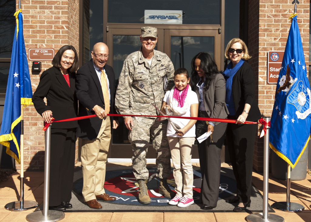 Retired Air Force Gen. Gene Renuart, Jill Renuart, Col. Michael Hough, 21st Space Wing vice commander, Stephanie Molina, Yvaal Hampton, STARBASE director, Barbara Koscak, STARBASE co-founder, cuts the ribbon during the opening ceremony, Feb. 2, 2015. Image Credit: USAF/Senior Airman Tiffany DeNault