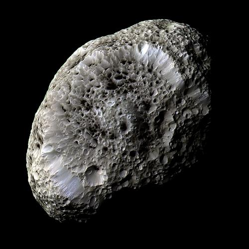 This stunning false-color view of Saturn's moon Hyperion reveals crisp details across the strange, tumbling moon's surface. Image Credit: NASA/JPL