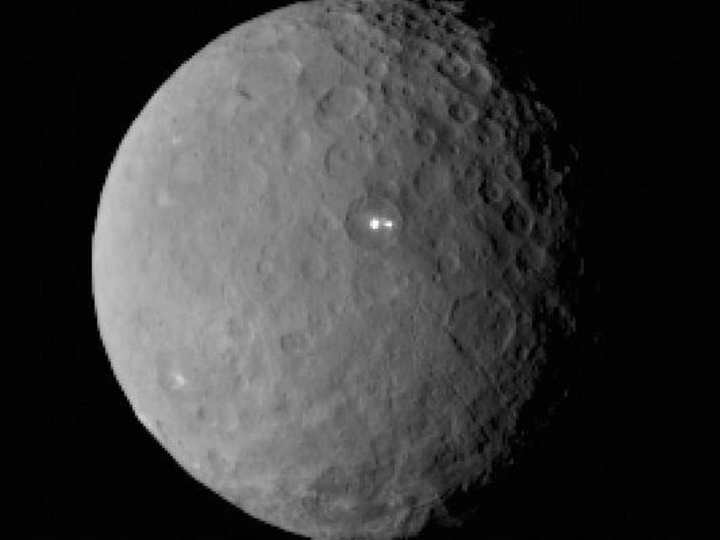 This image was taken by NASA's Dawn spacecraft of dwarf planet Ceres on Feb. 19 from a distance of nearly 29,000 miles (46,000 kilometers). It shows that the brightest spot on Ceres has a dimmer companion, which apparently lies in the same basin. Image Credit: NASA/JPL-Caltech/UCLA/MPS/DLR/IDA