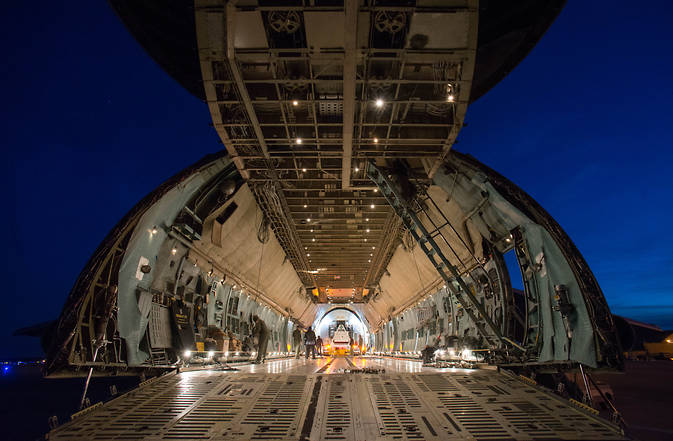 Rare glimpse into the mouth of a C-5 Charlie military transport plane, the largest cargo plane in the U.S. fleet, which was designed to carry tanks, just before STTARS (the Space Telescope Transporter for Air Road and Sea) was loaded for transport from Joint Base Andrews, Maryland, to Houston. Image Credit: NASA/Desiree Stover