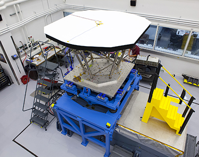 Technicians at the Johns Hopkins University Applied Physics Laboratory in Laurel, Md., prepare an engineering model of the Solar Probe Plus Thermal Protection System, or TPS, for vibration tests in October 2013. The main feature of the TPS is an 8-foot-diameter, 4.5-inch-thick, carbon-carbon, carbon foam shield that will sit atop the Solar Probe Plus spacecraft body. The system will protect Solar Probe Plus from temperatures exceeding 2,500 degrees Fahrenheit and impacts from hypervelocity dust particles as it flies through the sun's outer atmosphere. Image Credit: Johns Hopkins University Applied Physics Laboratory