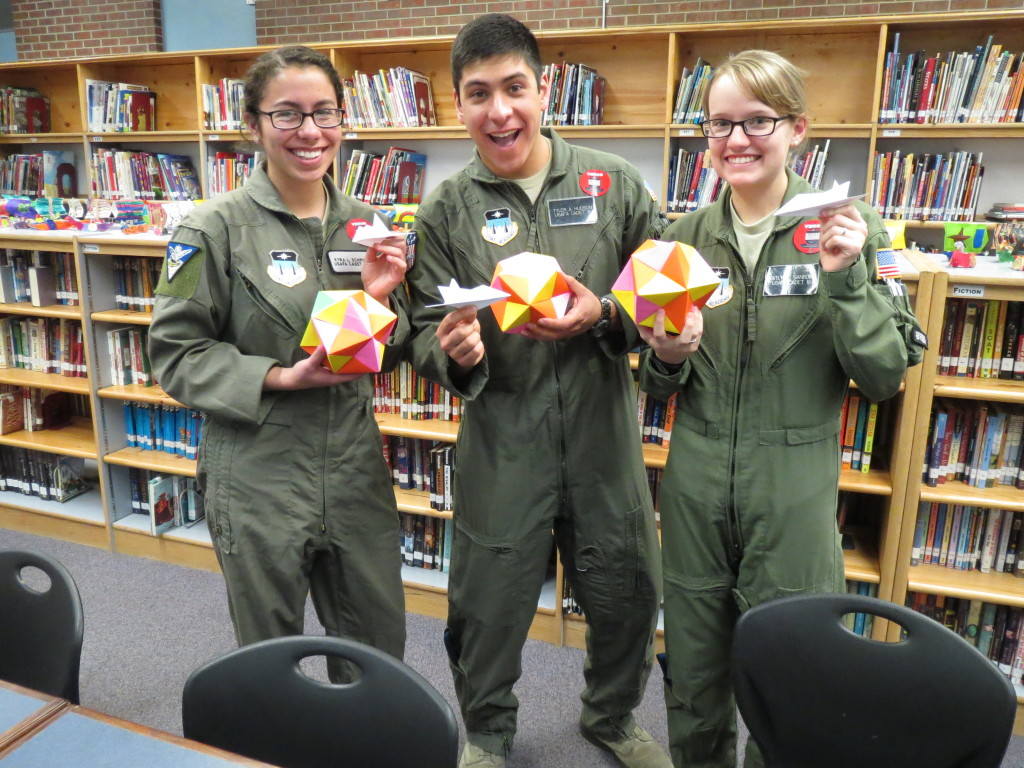 Cadet 3rd Class Kyra Schmidt (left), Cadet 2nd Class Tyler Hudson and Cadet 2nd Class Kaitlyn Sanborn, all members of the cadet-run STEM Club, hold the origami they made with students from the Classic Academy in Colorado Springs, Colo., Feb. 19, 2015. The cadets were invited to attend to help explain how origami relates to STEM subjects like engineering. Image Credit: U.S. Air Force Academy