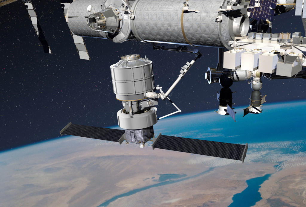 An illustration showing Lockheed Martin's solution for NASA's Commercial Resupply 2 Program. This image shows the Jupiter spacecraft, the Exoliner cargo container and the robotic arm docking to the International Space Station. Image Credit: Lockheed Martin