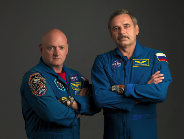 NASA astronaut Scott Kelly (left), Expedition 43/44 flight engineer and Expedition 45/46 commander; and Russian cosmonaut Mikhail Kornienko, Expedition 43-46 flight engineer, take a break from training at NASA's Johnson Space Center to pose for a portrait. Image Credit: NASA/Bill Stafford