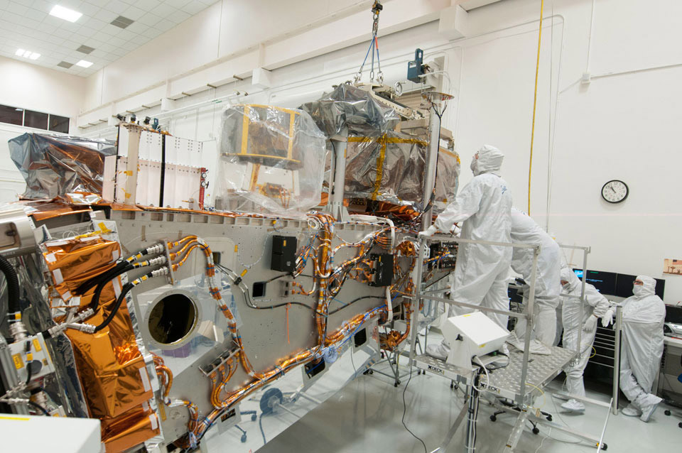 Ball and Raytheon technicians integrate the VIIRS Optical and Electrical Modules onto the JPSS-1 spacecraft. Image Credit: Ball Aerospace & Technologies Corp.