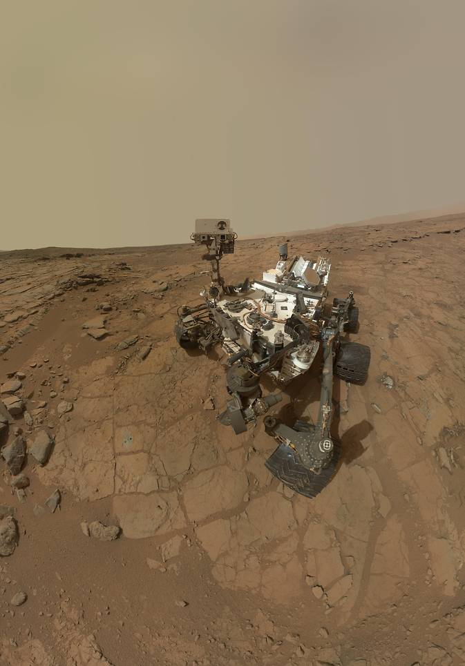 "This self-portrait of NASA's Mars rover Curiosity combines dozens of exposures taken by the rover's Mars Hand Lens Imager on Feb. 3, 2013 plus three exposures taken May 10, 2013 to show two holes (in lower left quadrant) where Curiosity used its drill on the rock target ""John Klein"". Image Credit: NASA/JPL-Caltech/MSSS"