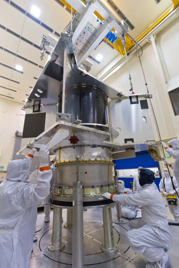 The OSIRIS-REx spacecraft core structure is successfully lowered and mated to the hydrazine propellant tank and boat tail assembly at Lockheed Martin, Denver, Colorado. Image Credit: Lockheed Martin