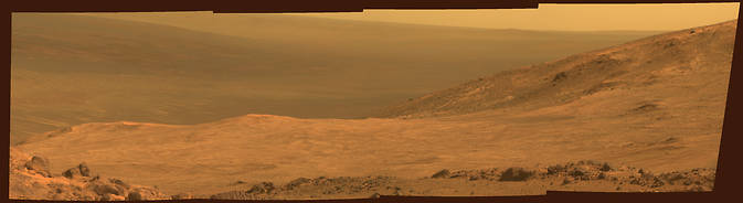 "This view from NASA's Opportunity Mars rover shows part of ""Marathon Valley,"" a destination on the western rim of Endeavour Crater, as seen from an overlook north of the valley. Image Credit: NASA/JPL-Caltech/Cornell Univ./Arizona State Univ."